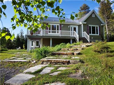 Tourist Home located between Baie St-Paul and La Malbaie,  with a splendid view.