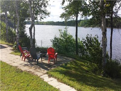 Cottage on the Cape with dock and spectacular view of big Tracadie river
