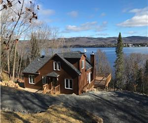 Beautiful cottage on the waterfront of Lake Archambault with a superb view on Mount Garceau St-Donat